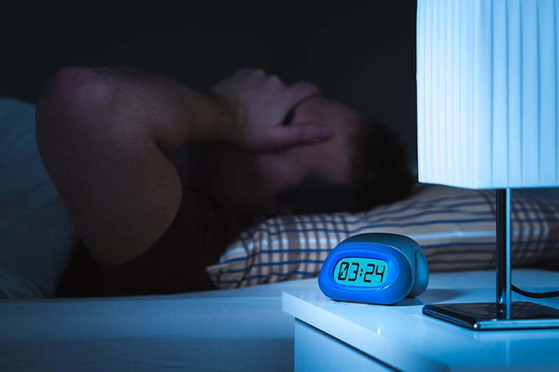 Person in bed unable to sleep at 3:24 am
