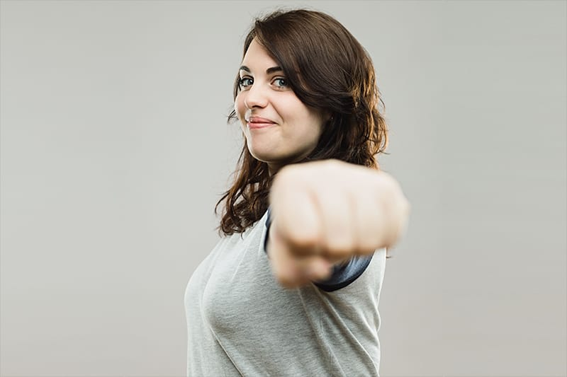 Woman pointing fist at camera