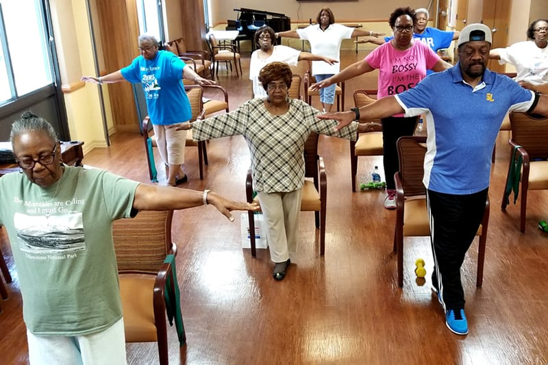 Older adults performing balance exercises - Photo from the National Council on Aging