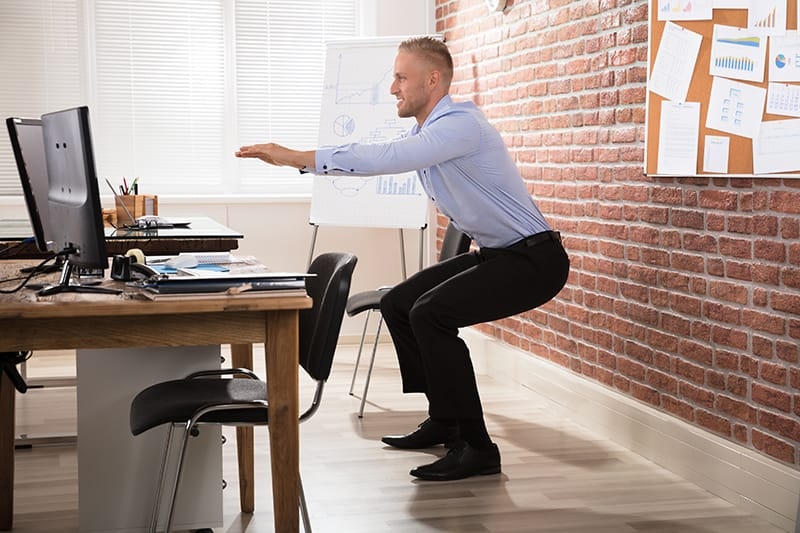 Workout While Working: 7 Exercises You Can Do at Your Desk