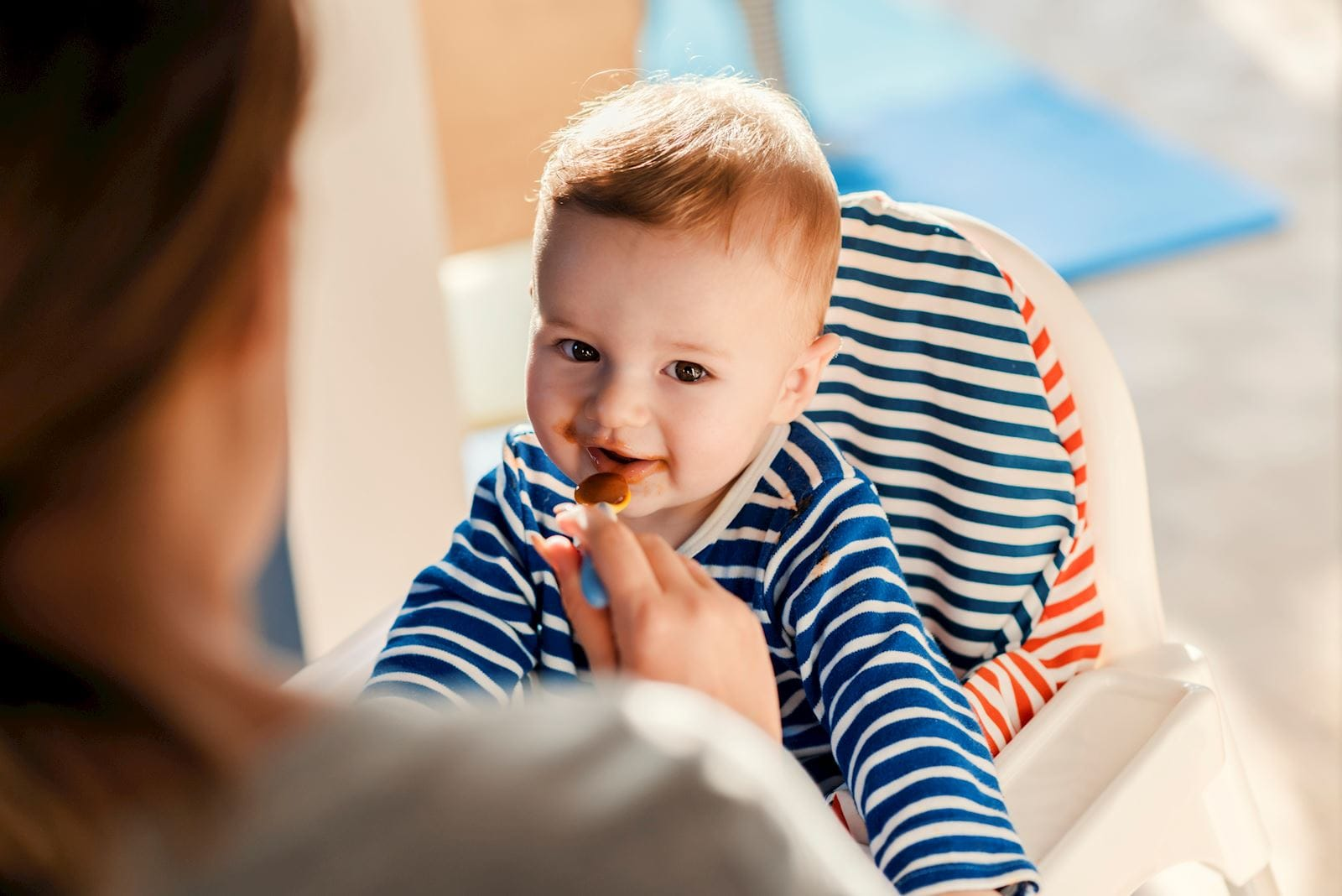 Baby eating food from a spoon