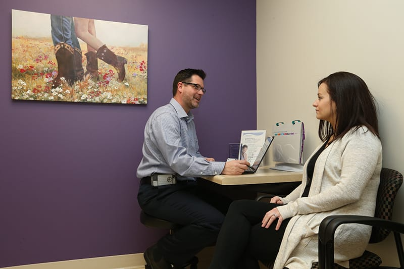 Physican and female patient having a conversation in doctors office
