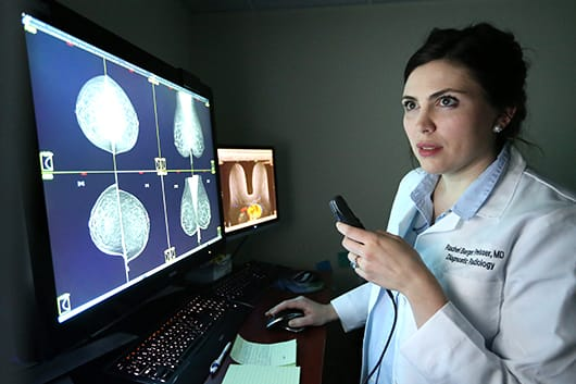 Dr. Preisser looking at digital mammography