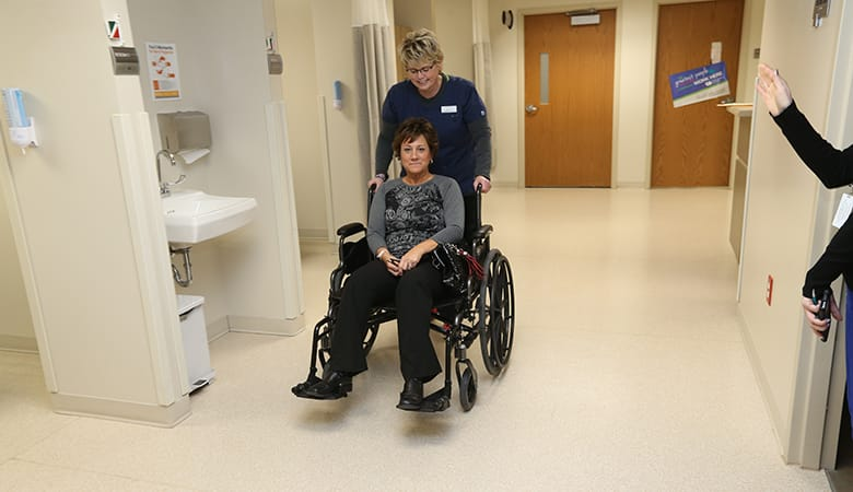 Endoscopy Center - nurse wheeling patient out after procedure is complete and patient is cleared to go home