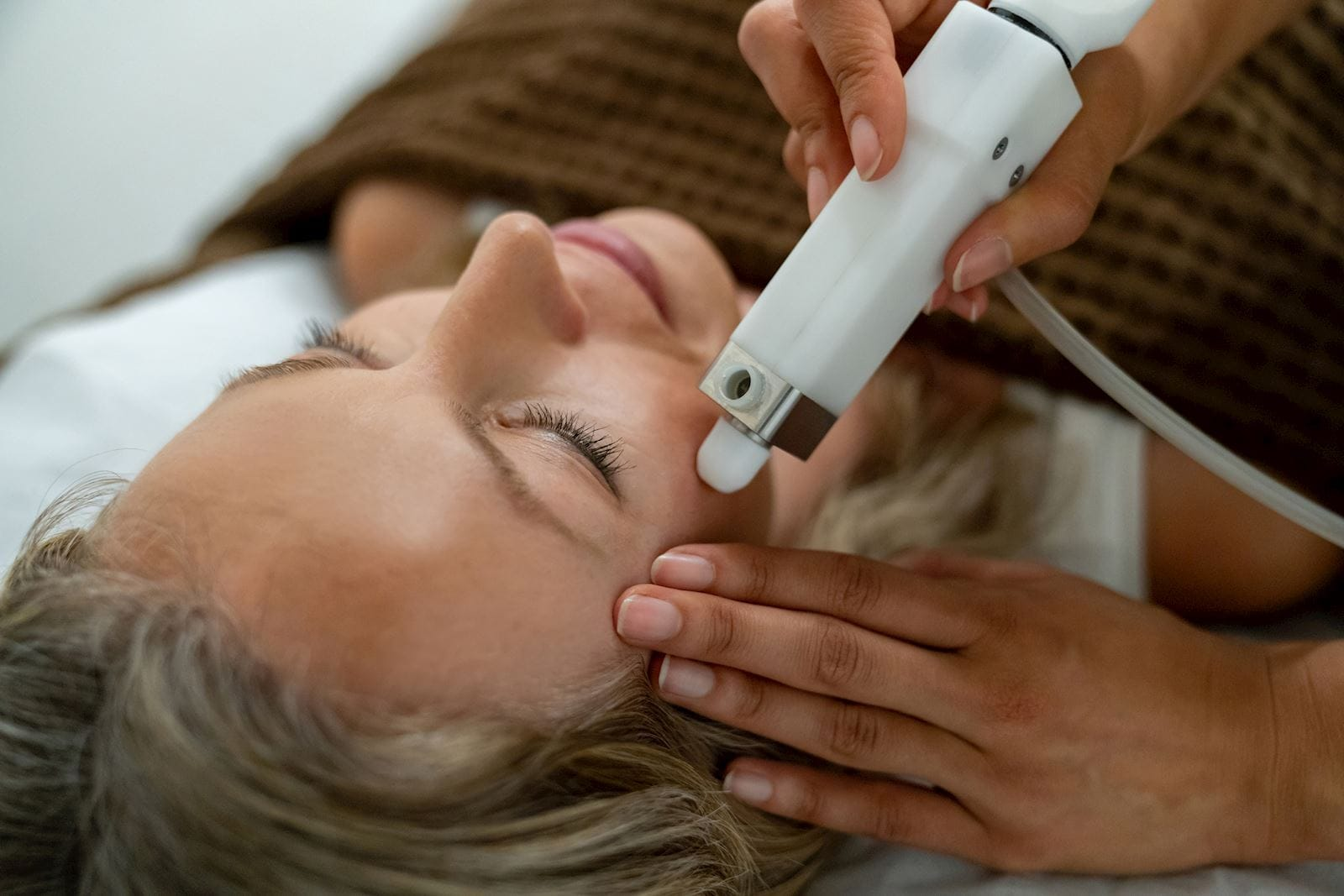 Woman getting a facial laser